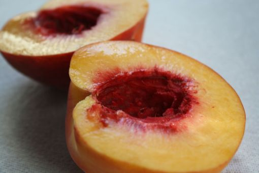 palisade peach cut in half